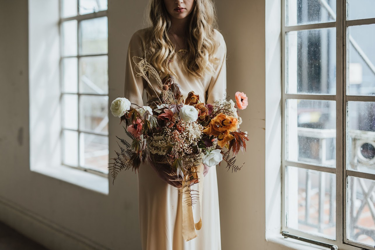 On My Hand styled shoot with Together Journal photography by Coralee Stone - model holding floral arrangement