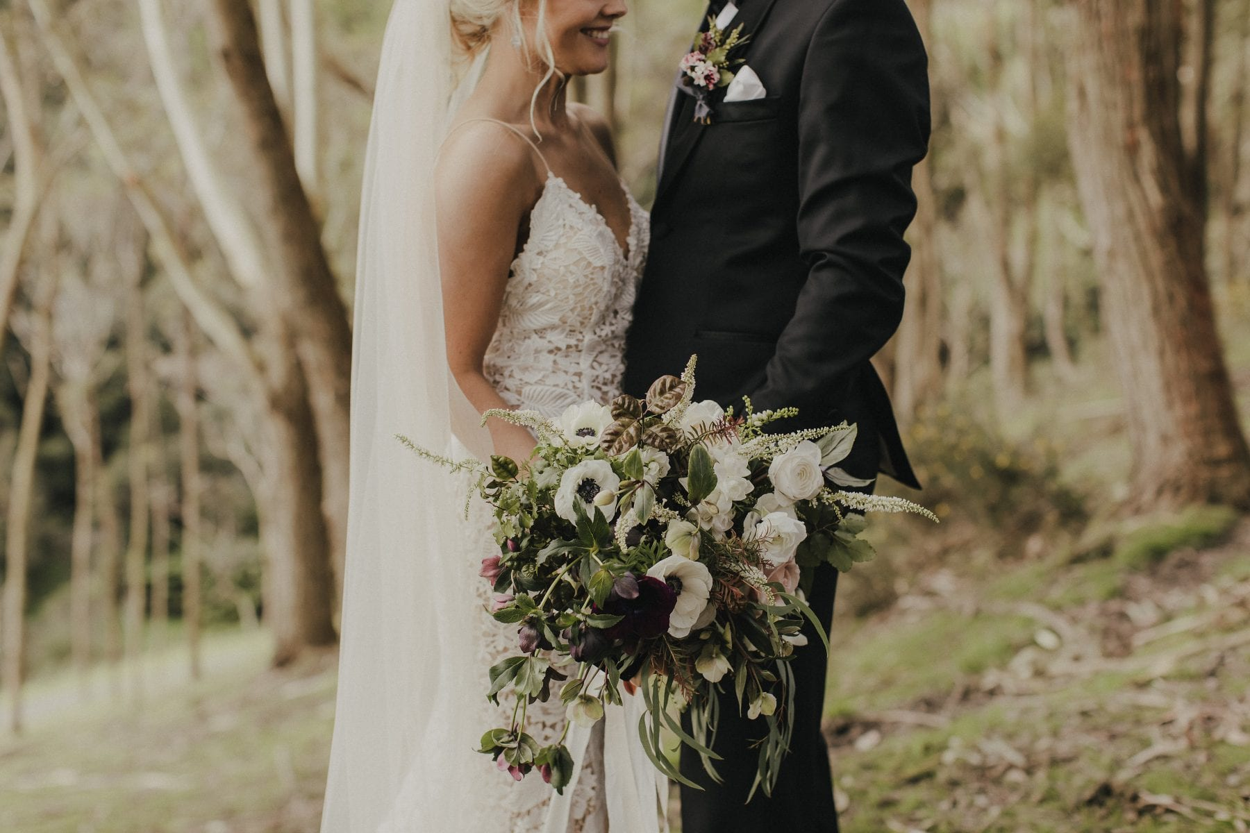 On My Hand Wedding flowers for real wedding - Gert and Trent in Kauri Bay Boomrock - bride and groom with bouquet