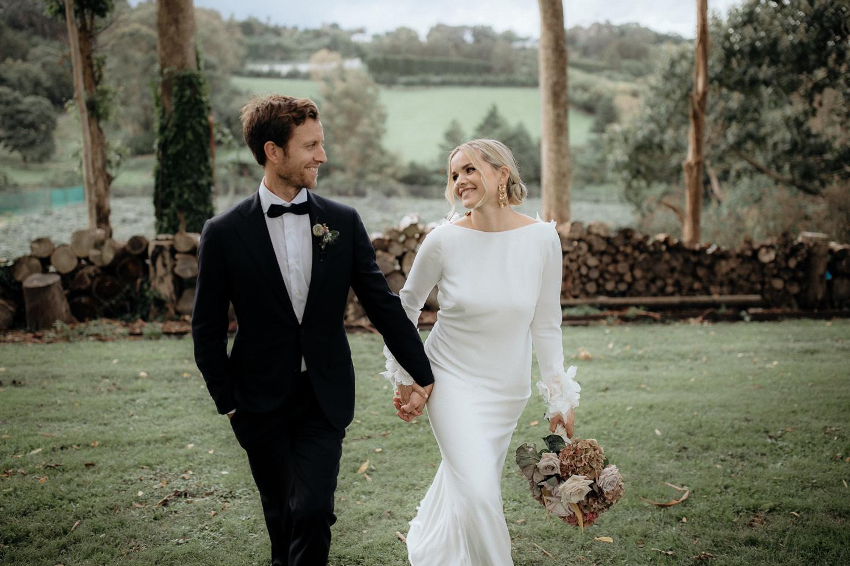 On My Hand wedding flowers - real wedding portfolio - Maggie and Matt - walking outdoors bride with bouquet