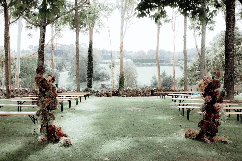 On My Hand wedding flowers - real wedding portfolio - Maggie and Matt - outdoor ceremony set up with floral arrangements