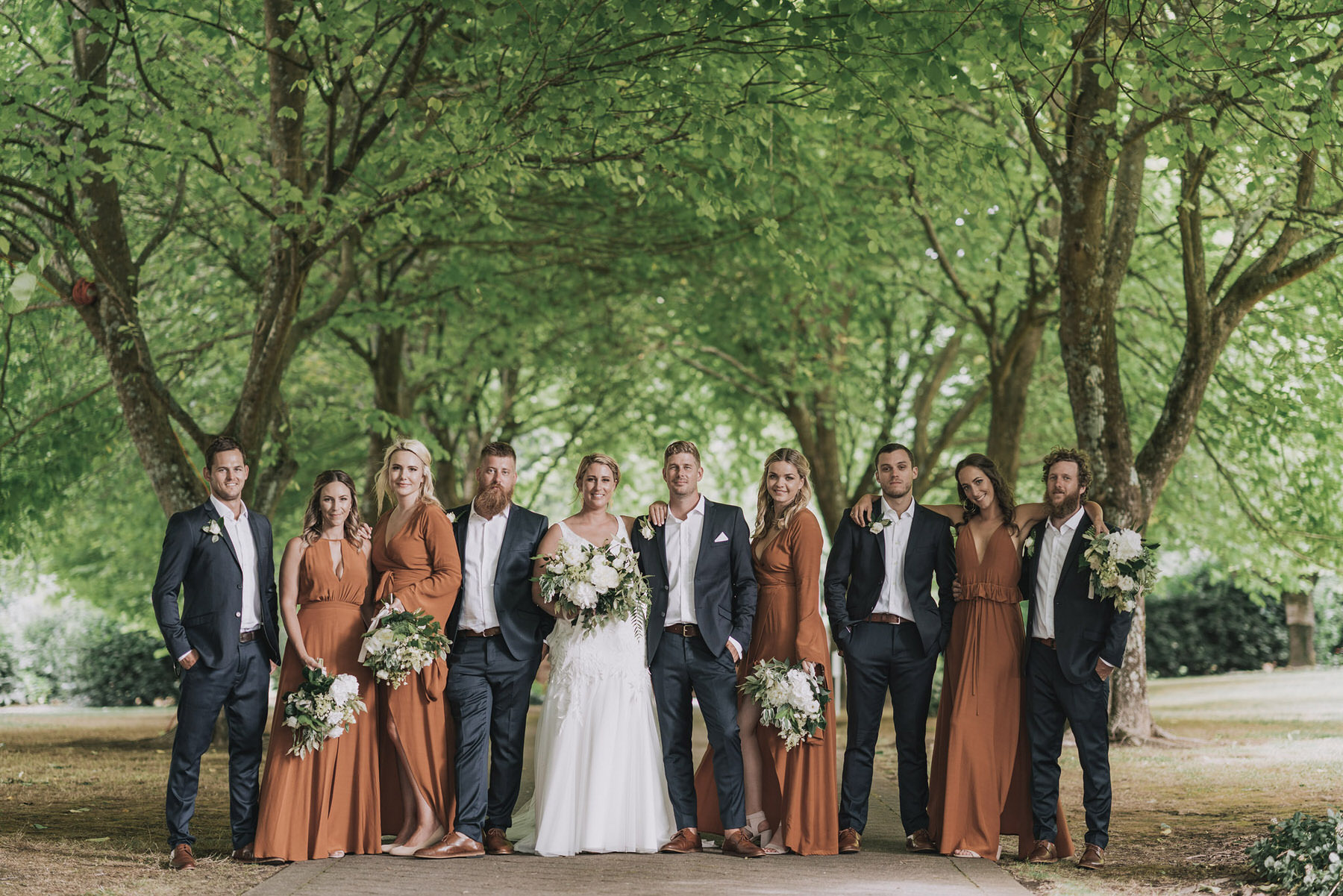 On My Hand wedding flowers - real wedding portfolio - Abbey and Ash - bridal party pose with bouquets and buttonholes