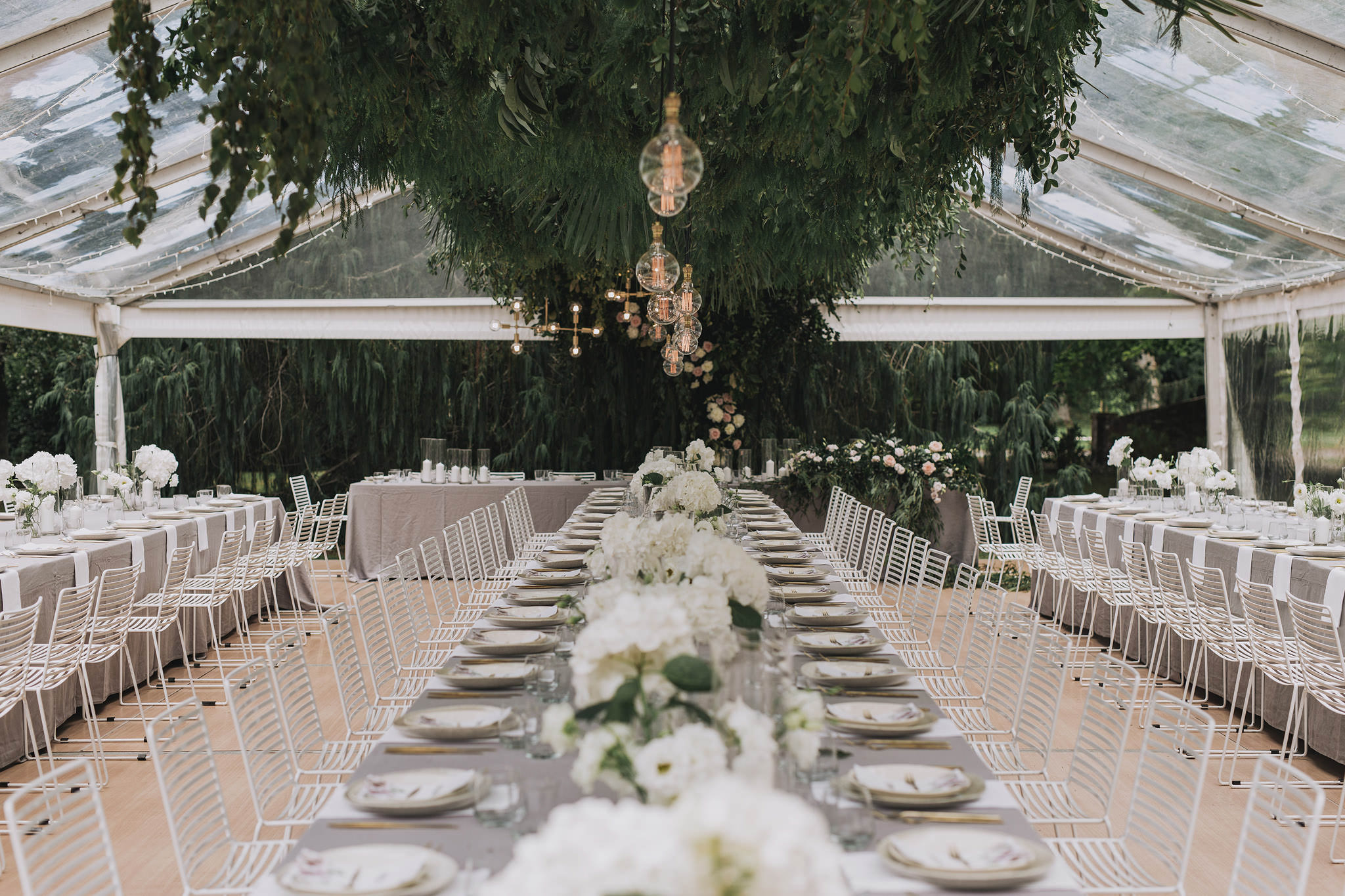 On My Hand wedding flowers - real wedding portfolio - Abbey and Ash - floral styling with hanging flowers and table runners in wedding reception marquee