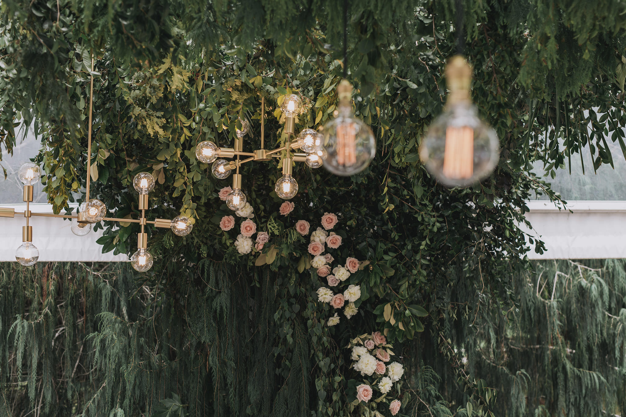 On My Hand wedding flowers - real wedding portfolio - Abbey and Ash - hanging flowers and lights in wedding reception marquee