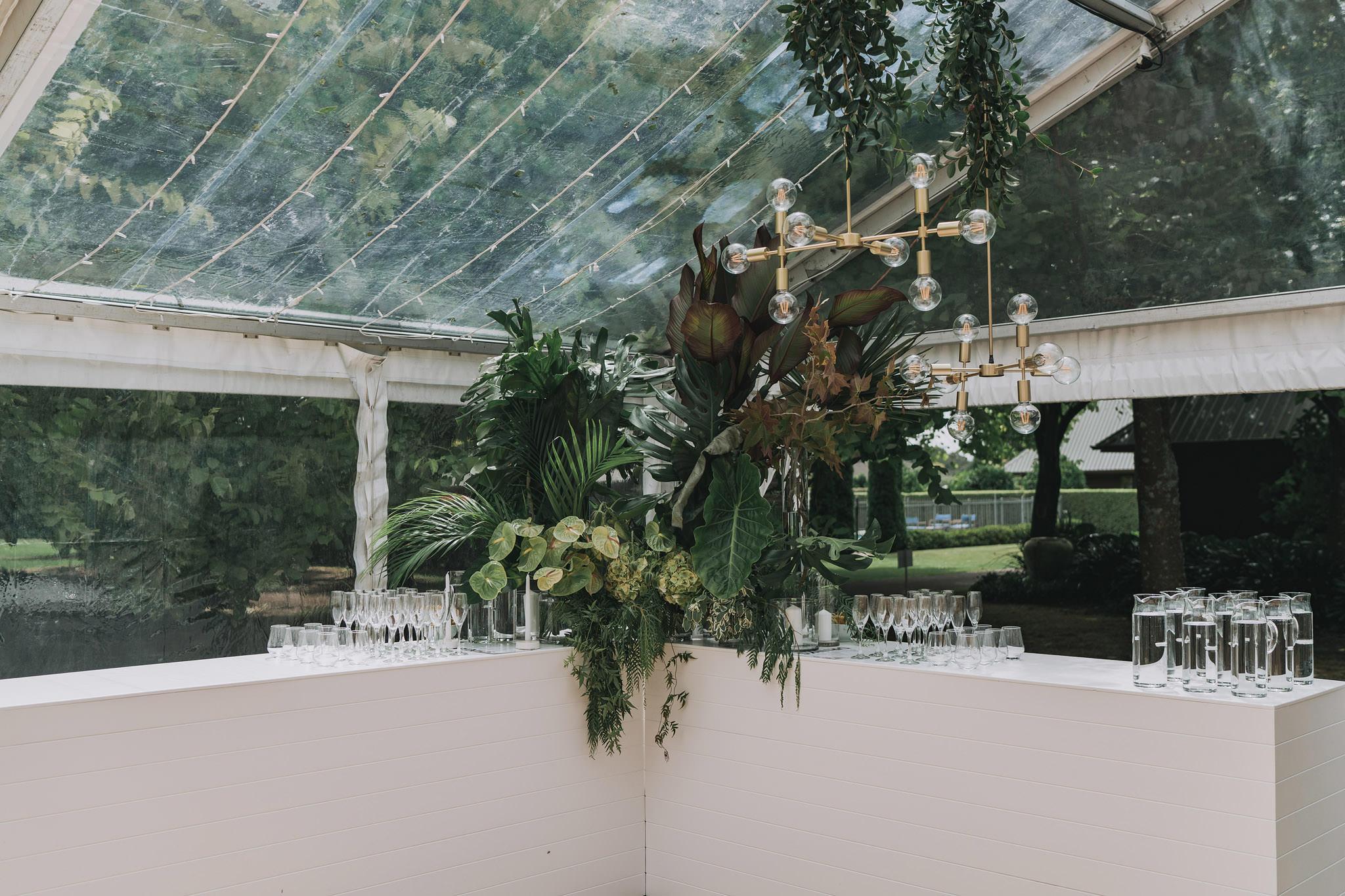 On My Hand wedding flowers - real wedding portfolio - Abbey and Ash - bar flower decorations in wedding reception marquee