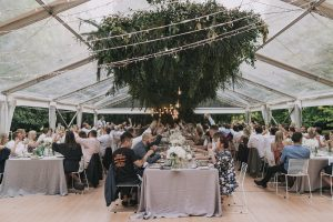 Real wedding Abbey and Ash, reception clear marquee with stunning florals along the roof - On My Hand florals and event styling
