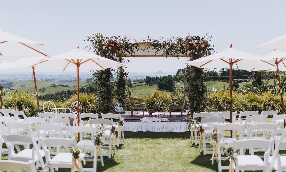 Stunning floral archway set outdoors created by On My Hand florals and event styling in Tauranga