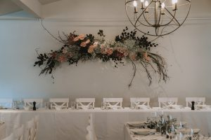 Real wedding Jo and Callum - beautiful wall floral arrangement by On My Hand Tauranga florals and event styling