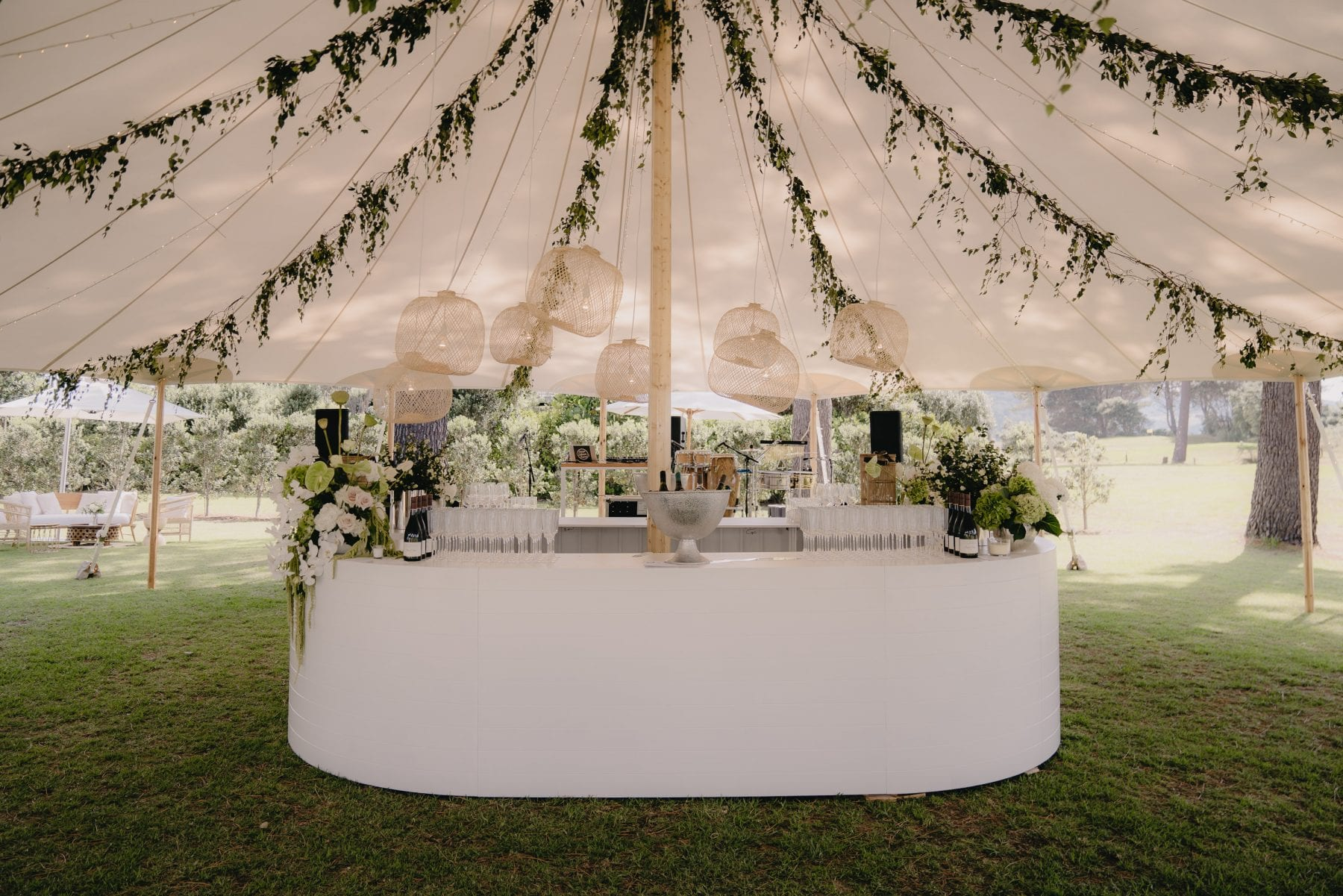 On My Hand wedding flowers real wedding - Rueben and Hannah - floral styling for wedding reception marquee hanging flowere and table runners