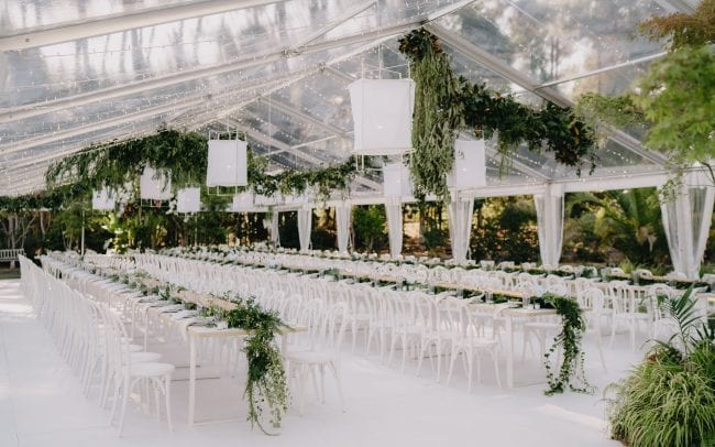 On My Hand wedding flowers real wedding - Nicole and Billy - floral styling for wedding reception marquee hanging flowers and table runners