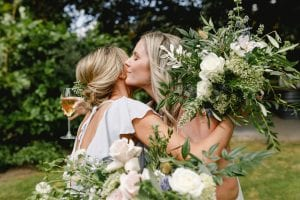 On My Hand wedding flowers - real wedding with French garden elegance couple kiss with bouquets