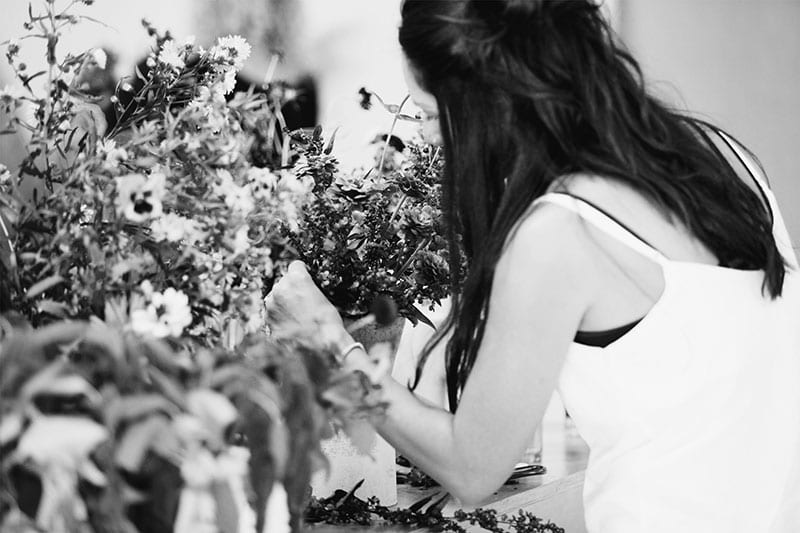 On My Hand Floral arranging and styling public workshops in Tauranga - female arranging flowers