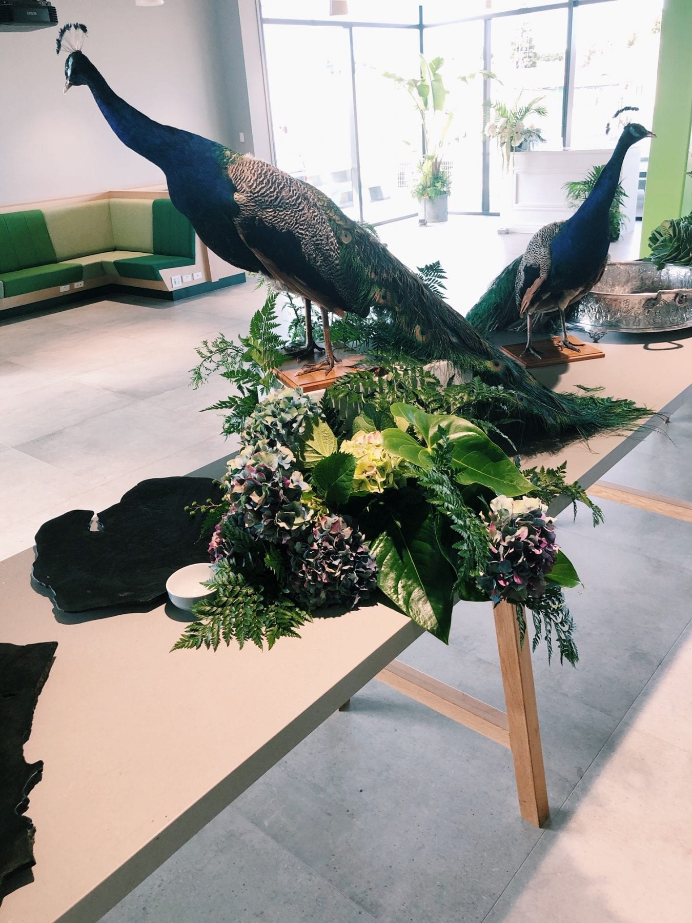 Table floral display with peacocks from On My Hand Floral and Styling in Tauranga.