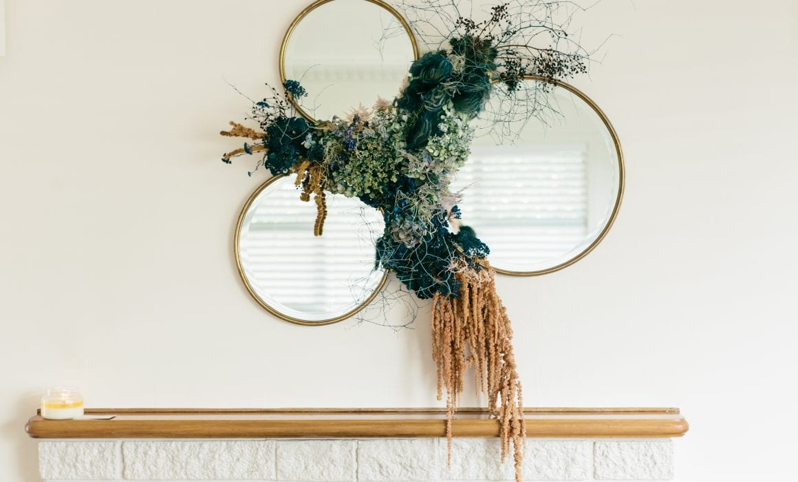 Stunning dried floral wall installation around mirrors for Cashmore clinic - On My Hand Floral and Styling in Tauranga.