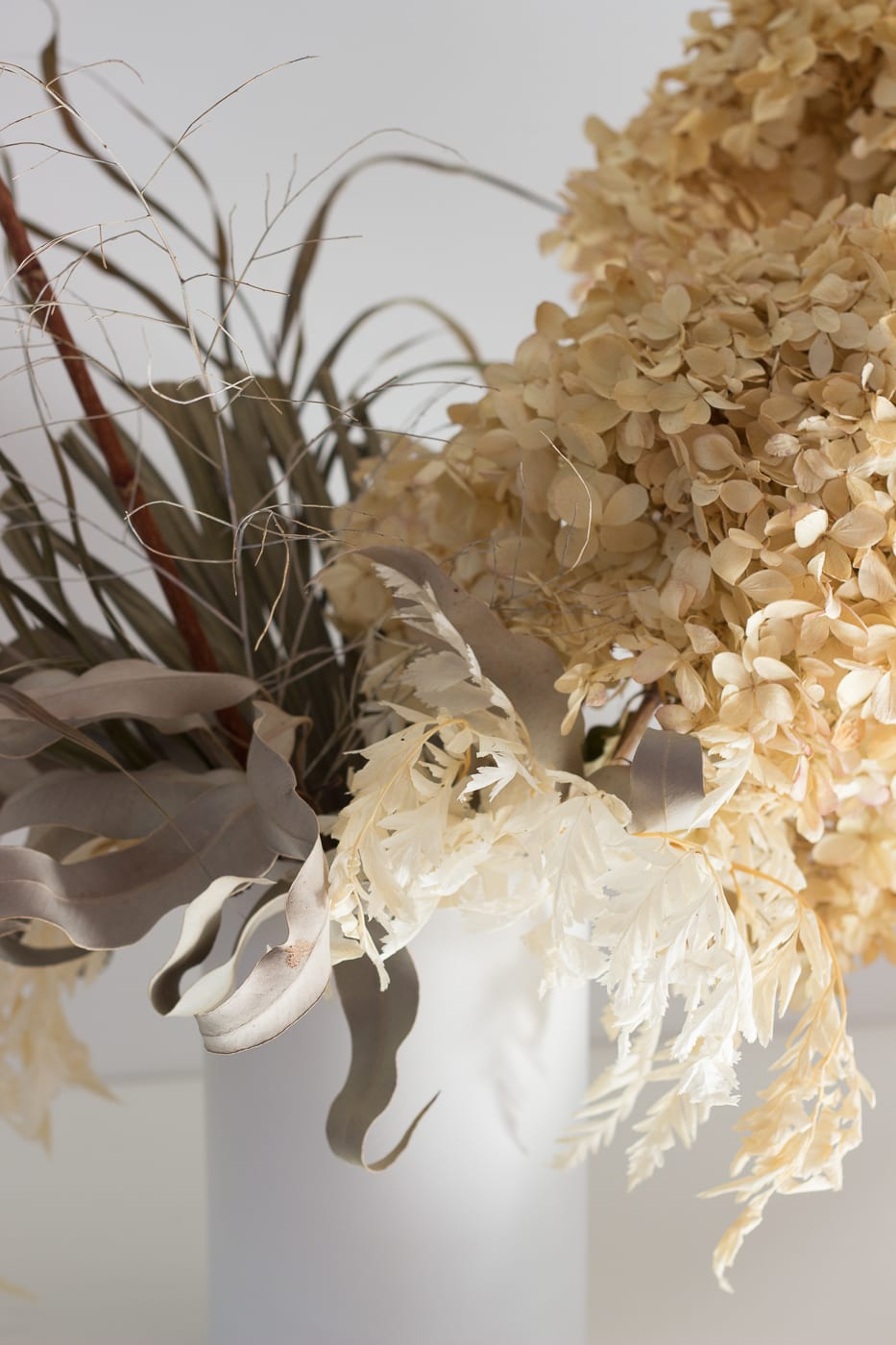 Close up of natural colour medium arrangement in white vase from On My Hand Florals and Styling, Tauranga, Bay of Plenty.