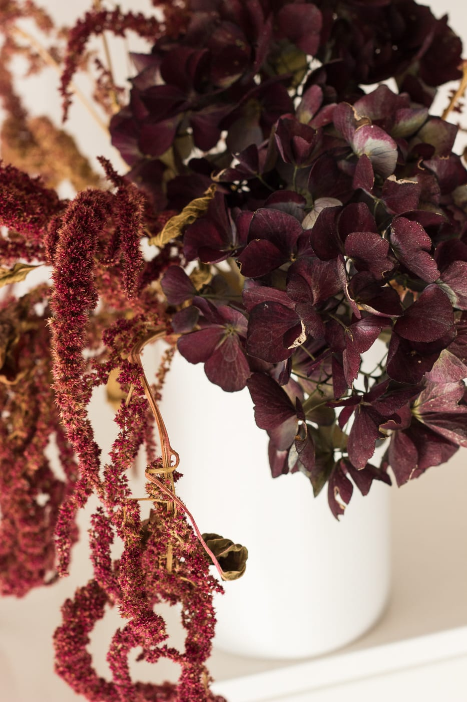 Close up of Medium merlot arrangement in white vase from On My Hand Florals and Styling, Tauranga, Bay of Plenty.