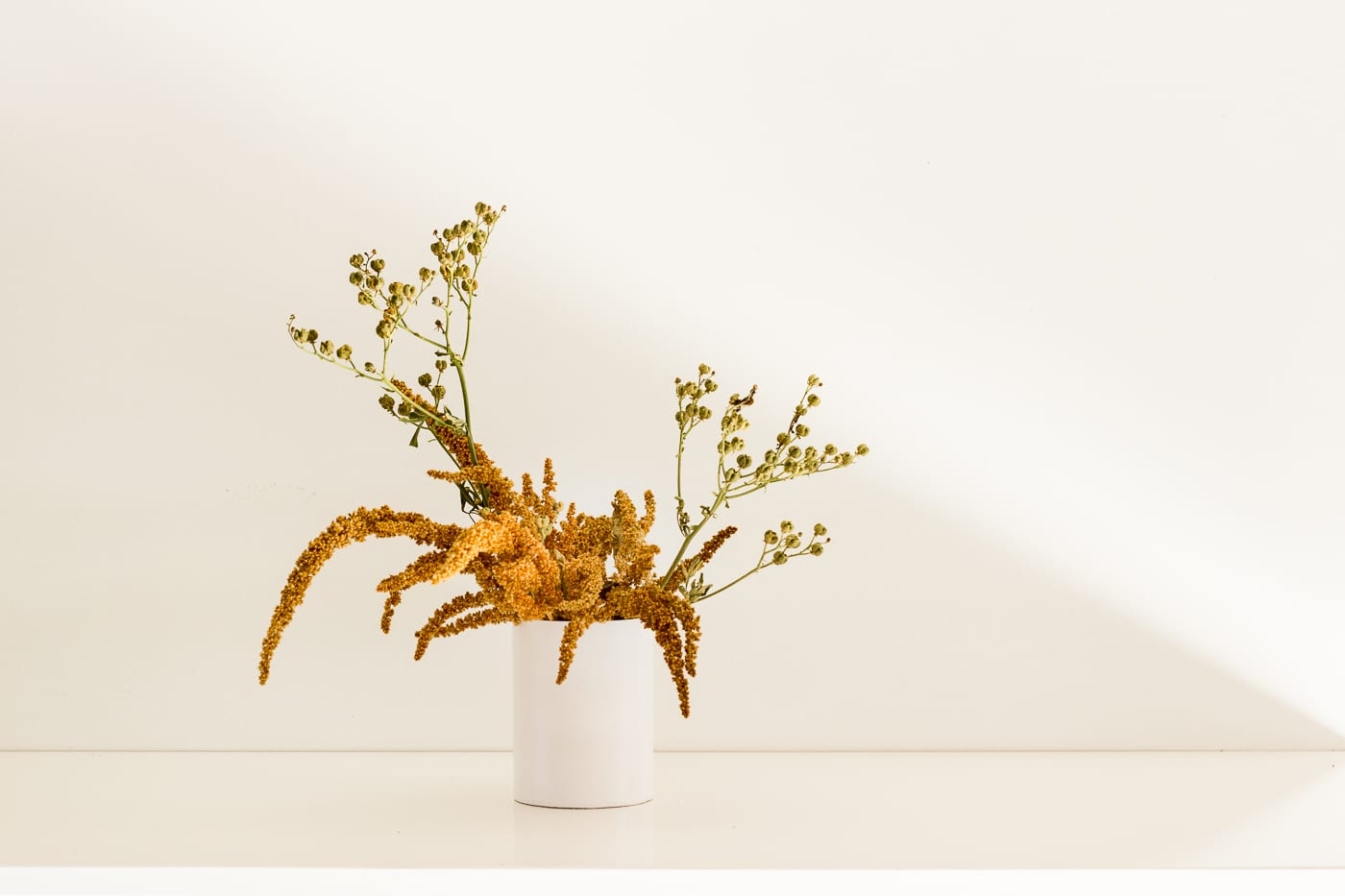 Natural style dried mini arrangement in vase from On My Hand Florals and Styling, Tauranga, Bay of Plenty.