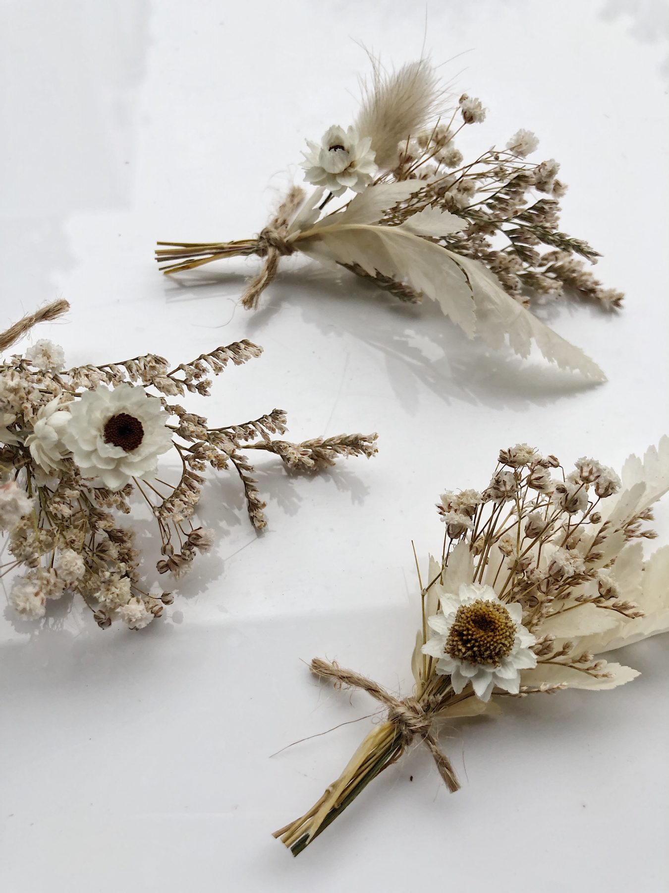 Dried tiny whites bouquets from On My Hand Florals and Styling. 3 minis.