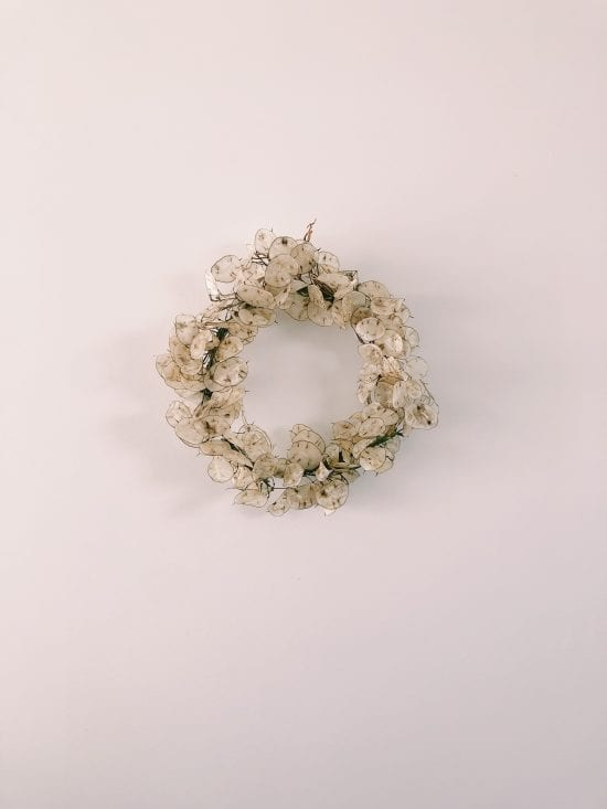 Close up of stunning wreath from On My Hand Florals and Styling. Mini Lunaria Wreath on blank wall
