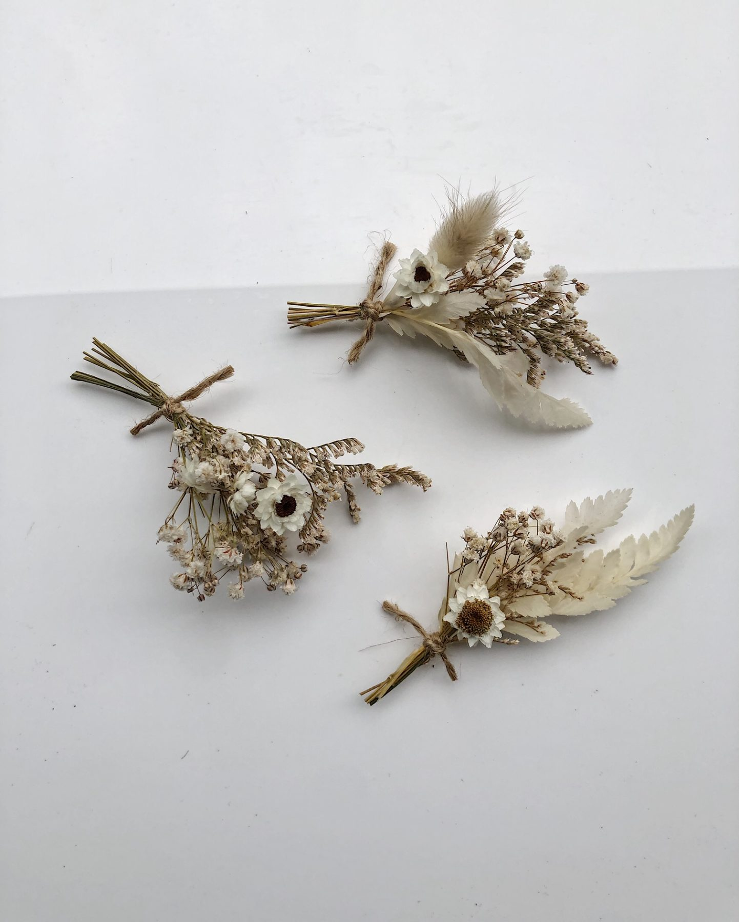Dried tiny whites bouquets from On My Hand Florals and Styling.