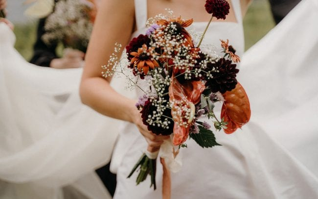 On My Hand Florist for Weddings and Events in Tauranga, Bay of Plenty. Lana and Wynn real wedding - close up of bridal bouquet in autum colours.