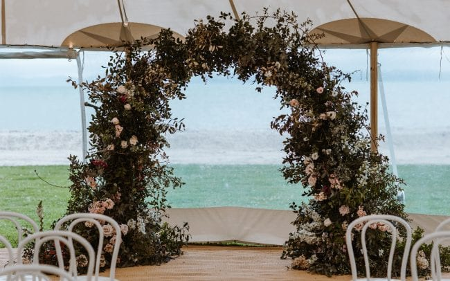 Real Wedding Rachel and Jonny with wedding florals from On My Hand - large floral archway for the wedding ceremony.